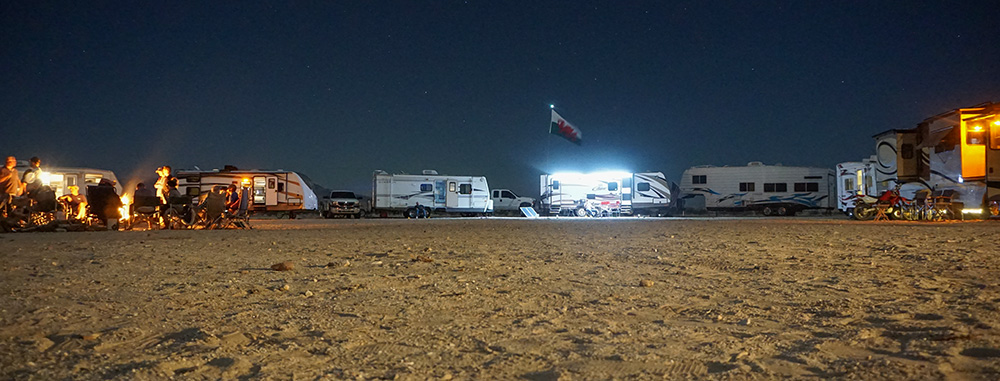 camping circle, friends, flag, welsh flag, camping trip, Ocotillo Wells, dry camping, boondocking